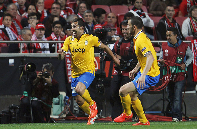 Juventus's Carlos Tevez (left) celebrates his goal against Benfica during their Europa League semi-final first leg match at Luz stadium in Lisbon on Thursday
