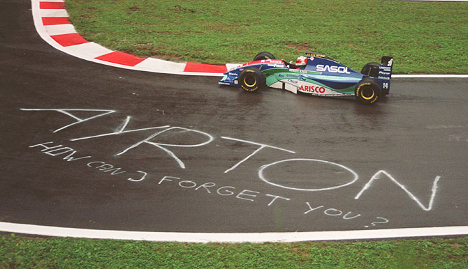 Rubens Barrichello of Brazil drives past a tribute to Ayrton Senna written on the tarmac during qualifying of the Belgian GP in 1994