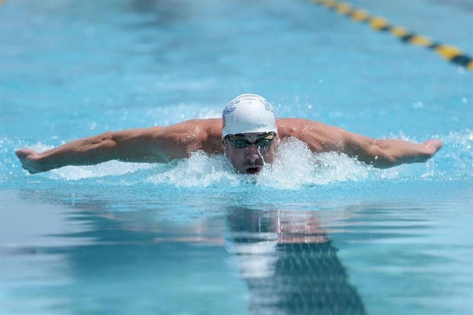Michael Phelps swims during the men's 100m butterfly race at the 2014 USA Swimming Grand Prix Series at Skyline Aquatic Center on Thursday