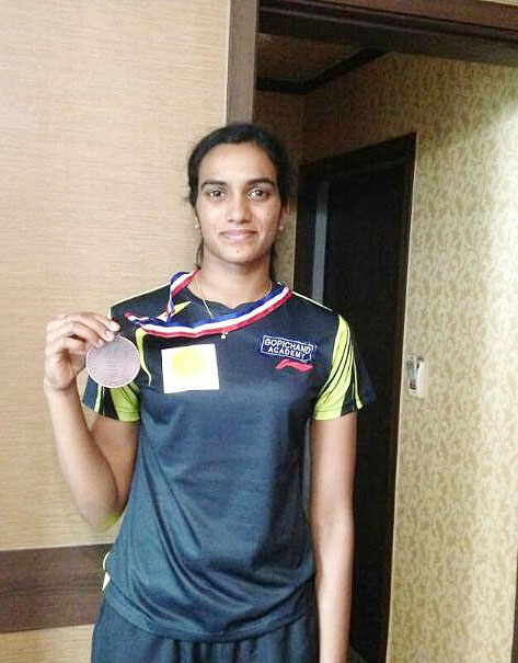 PV Sindhu poses with the Asian Championships bronze medal on Saturday