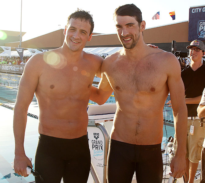 Ryan Lochte (left) and Michael Phelps (second place) pose together after finishing the Men's 100m Butterfly final