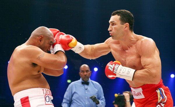 Wladimir Klitschko (right) of Ukraine exchanges punches with Alex Leapai of Australia during their WBO, WBA, IBF and IBO heavy weight title fight