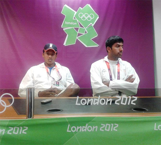 Mahesh Bhupathi (left) with Rohan Bopanna speak to reporters after their exit from the 2012 London Olympics.