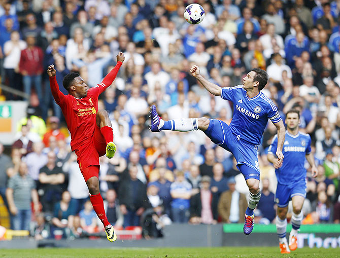 Liverpool's Daniel Sturridge (left) challenges Chelsea's Frank Lampard during their match on Sunday