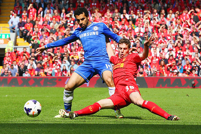 Mohamed Salah of Chelsea is tackled by Jon Flanagan of Liverpool during their match on Sunday
