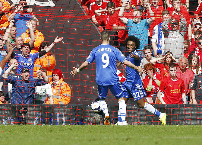 Chelsea's Willian (right) celebrates with teammate Fernando Torres after scoring a goal against Liverpool on Sunday