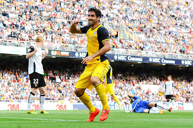 Atletico de Madrid's Raul Garcia celebrates after scoring the opening goal against Valencia during their La Liga match at Estadio Mestalla in Valencia on Sunday