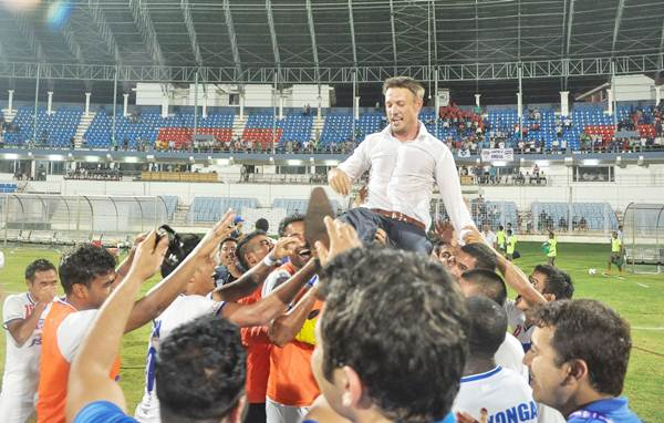 Bengaluru FC players hoist their coach Ashley Westwood after beating Sporting Clube de Goa and ending their I-League campaign on a winning note.