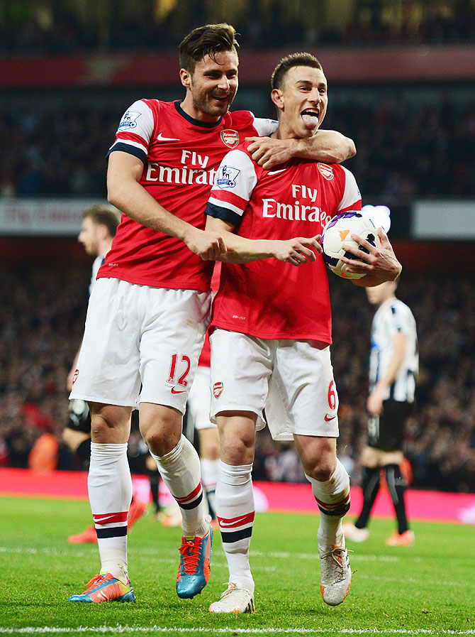 Laurent Koscielny of Arsenal celebrates wth Olivier Giroud (left) after scoring against Newcastle United during their English Premier League match at Emirates Stadium in London, England on Monday