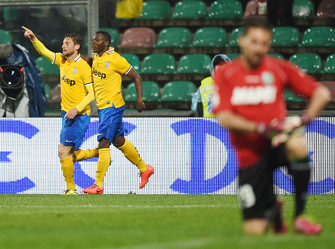Claudio Marchisio of Juventus celebrates after scoring the goal 1-2 during their Serie A match against US Sassuolo Calcio at Mapei Stadium in Sassuolo on Monday
