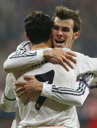 Real Madrid's Cristiano Ronaldo celebrates with Gareth Bale (right) after scoring a goal against Bayern Munich