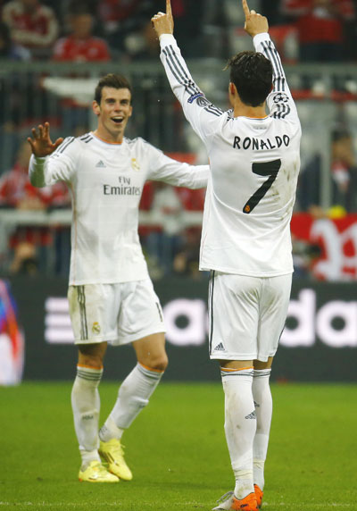 Real Madrid's Cristiano Ronaldo (right) celebrates his second goal against Bayern Munich with teammate Gareth Bale