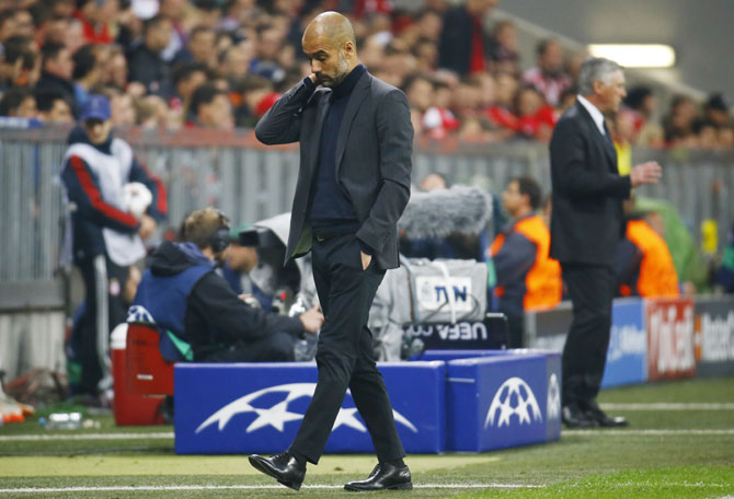 Bayern Munich's coach Josep Guardiola reacts