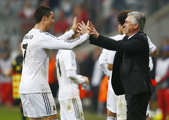Real Madrid's Cristiano Ronaldo celebrates with coach Carlo Ancelotti