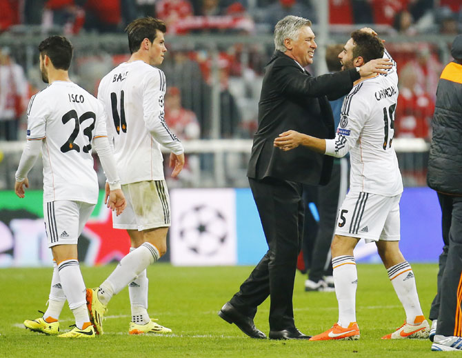Real Madrid's coach Carlo Ancelotti (second right) celebrates with Daniel Carvajal (right) after defeating Bayern Munich