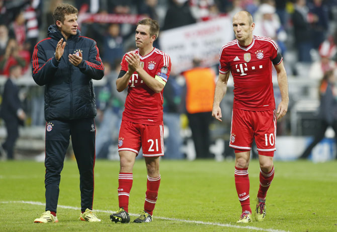 Bayern Munich's Thomas Mueller, Philipp Lahm and Arjen Robben (left to right) react after losing the Champion's League semi-final second leg