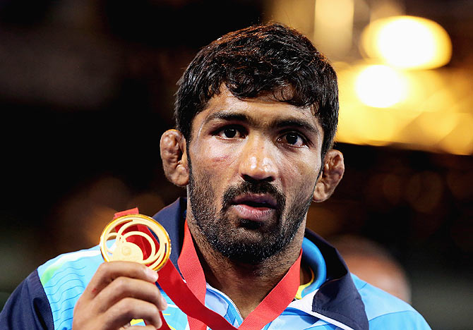 Gold medallist Yogeshwar Dutt of India poses during the medal ceremony for the Men's FS 65 kg at Scottish Exhibition and Conference Centre during day eight of the Glasgow 2014 Commonwealth Games on Thursday