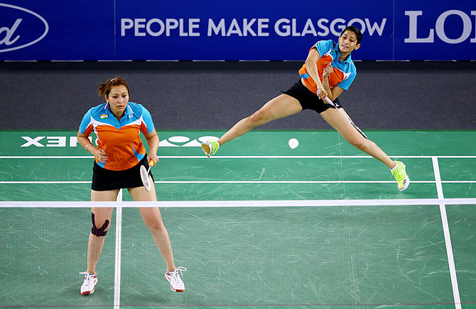 Ashwini Ponnappa and Jwala Gutta of India in action at the Glasgow 2014 Commonwealth Games