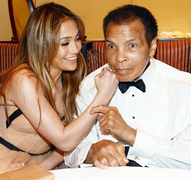 Singer Jennifer Lopez and boxer Muhammad Ali at