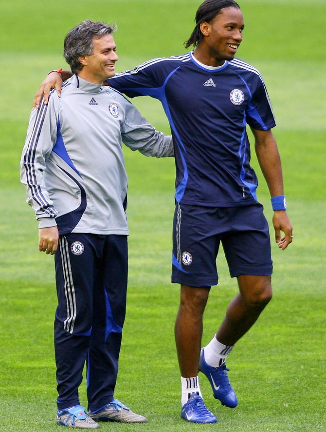 Chelsea Coach Jose Mourinho, right, shares a joke with Didier Drogba