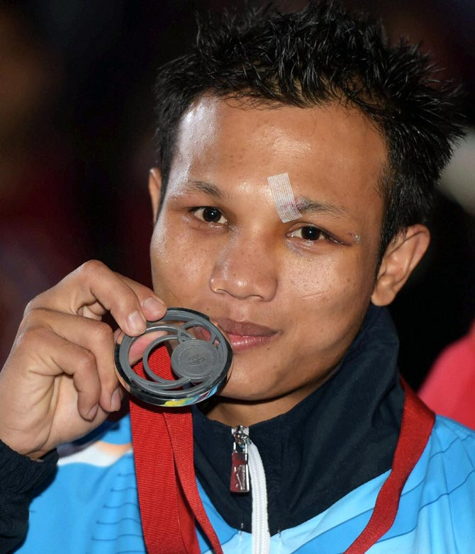 Devendro Singh Laishram of India poses with the silver medal