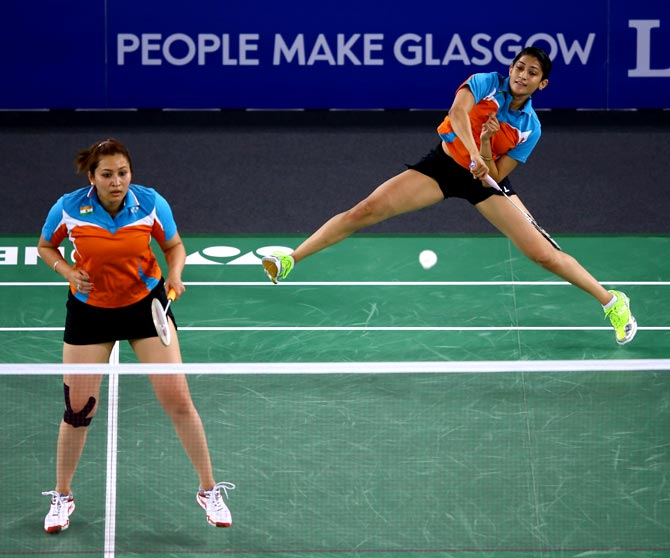 Ashwini Ponnappa (right) and Jwala Gutta of India in action