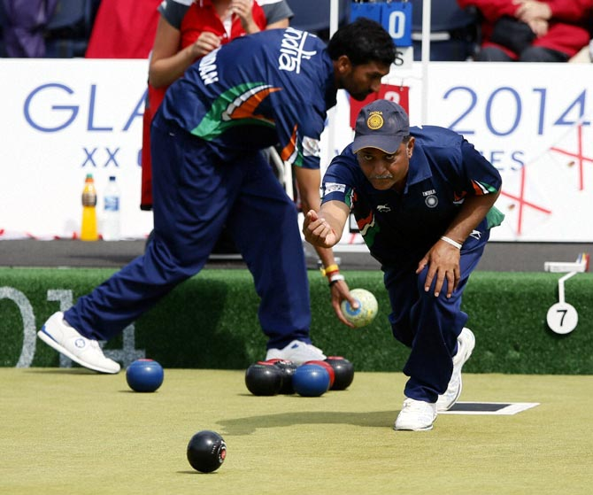 Dinesh Kumar of India bowls during the Lawn Bowls bronze medal match against Australia