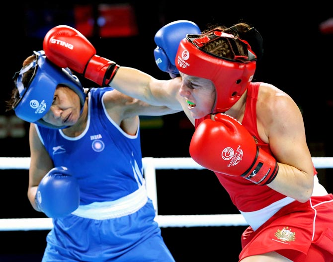 Laishram Sarita Devi of India (left) in action against Shelley Watts of Australia