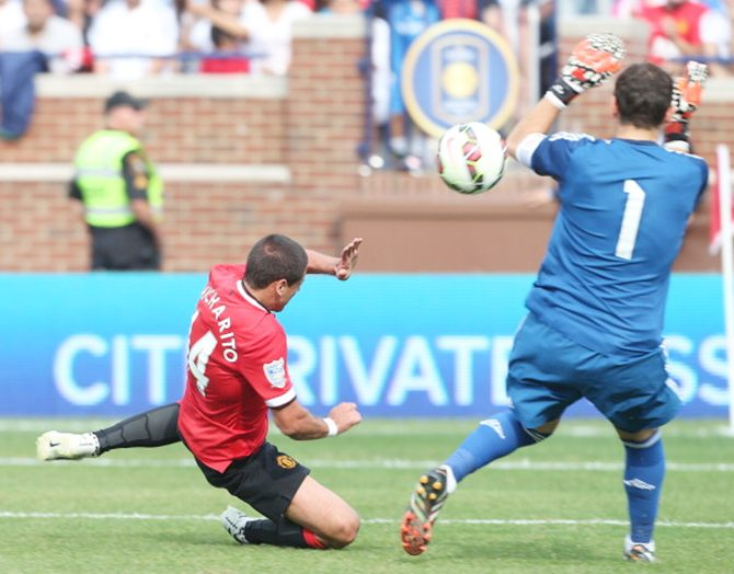 Javier 'Chicharito' Hernandez scores Manchester United's third goal past Real keeper Iker Casillas