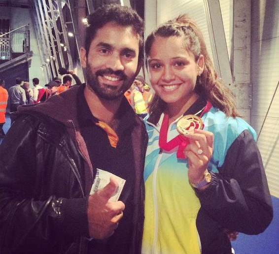 India's Dipika Pallikal is joined by boyfriend Dinesh Karthik after winning the squash doubles gold with Joshna Chinappa on Saturday