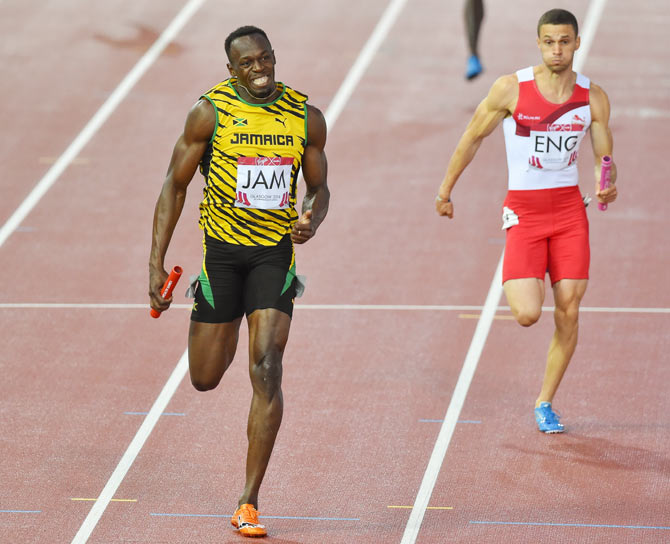 Usain Bolt of Jamaica runs the anchor leg in the mens 4x100m relay during day 10 of the 20th Commonwealth Games at Hampden Park Athletics stadium on Saturday
