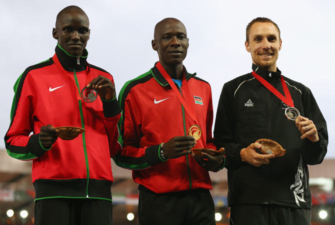 (Left-Right) Silver medalist Ronald Kwemoi of Kenya, gold medalist James Kiplagat Magut of Kenya and bronze medalist Nick Willis of New Zealand pose on the podium during the medal ceremony for the Men�s 1500 metres at Hampden Park on Saturday