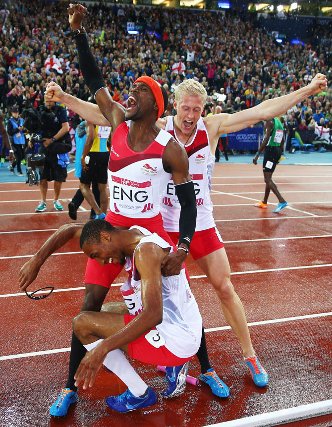 Conrad Williams, Matthew Hudson-Smith and Daniel Awde of England celebrate winning gold in the Men's 4x400 metres relay at Hampden Park on Saturtay
