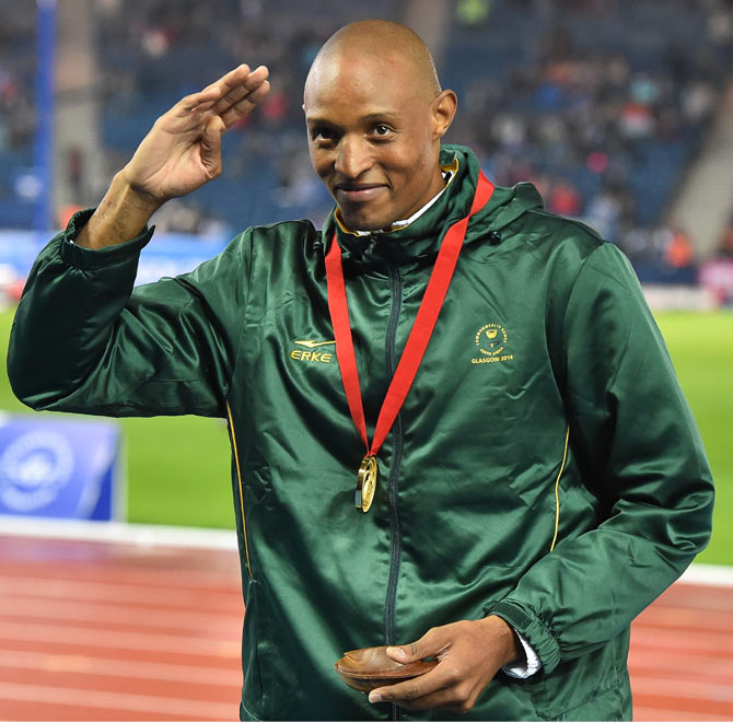 Khotso Mokoena of South Africa with his gold medal in the mens triple jump on Saturday