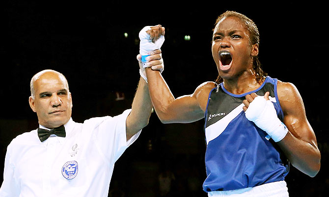 Nicola Adams (right) of England celebrates winning the gold medal against Michaela Walsh of Northern Ireland in the Women's Fly (48 - 51kg) Final at SSE Hydro during day ten of the Glasgow 2014 Commonwealth Games on Saturday