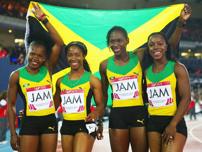 Schillonie Calvert, Shelly-ann Fraser-Pryce, Kerron Stewart and Veronica Campbell-Brown of Jamaica celebrate winning gold in the Women's 4x100 metres relay final on Saturday