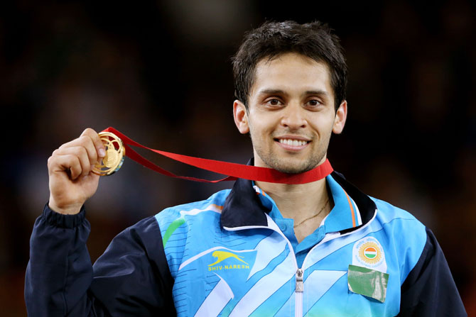 Gold medalist Kashyap Parupalli of India poses in the medal ceremony