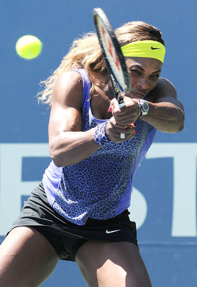 Serena Williams of the United States plays against Andrea Petkovic of Germany during Day 5 of the Bank of the West Classic at the Taube Family Tennis Stadium on Saturday