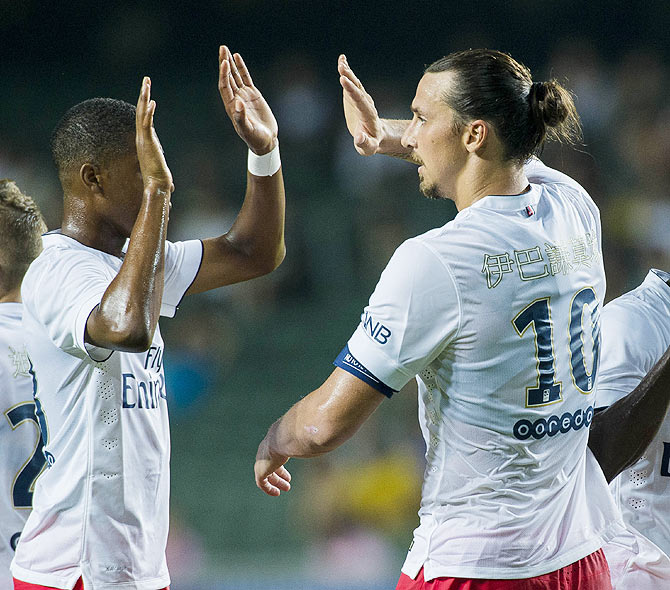 Zlatan Ibrahimovic of Paris Saint-Germain celebrates with teammates after scoring a goal during the friendly match between Kitchee and Paris Saint-Germain at Hong Kong Stadium on Saturday
