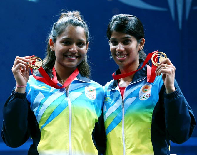 Dipika Pallikal (left) and Joshana Chinappa of India celebrate with their gold medals
