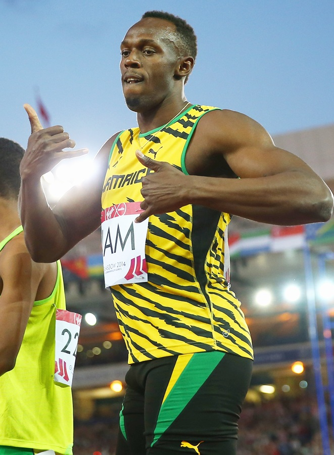 Usain Bolt of Jamaica competes in the Men's 4x100 metres relay