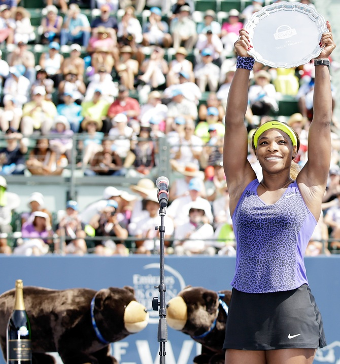 Serena Williams of the USA holds up the trophy after beating Angelique Kerber of   Germany in the finals of the Bank of the West Classic at the Taube Family Tennis Stadium