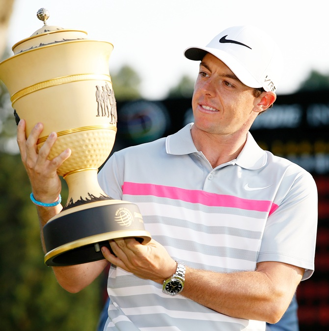 Rory McIlroy of Northern Ireland holds the Gary Player Cup trophy after winning the World Golf Championships-Bridgestone Invitational