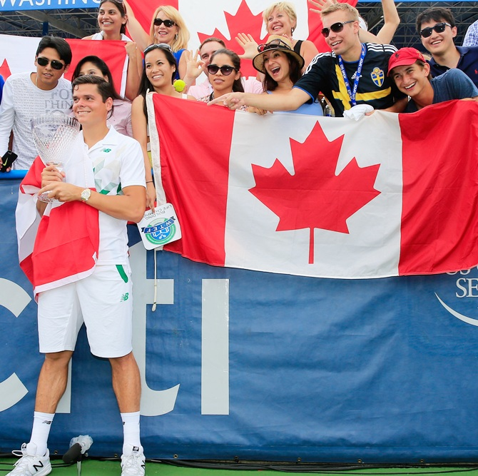 Milos Raonic of Canada poses with fans after defeating Vasek Pospisil of Canada during the mens final of the Citi Open at the William HG FitzGerald Tennis Center