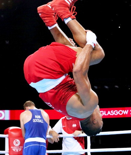 Joseph Joyce of England celebrates winning the gold medal against Joseph Goodall of Australia in the Men's Super Heavy (+91kg) Final at SSE Hydro during day ten of the Glasgow 2014 Commonwealth Games