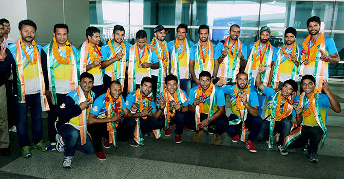 Members of the Indian Hockey team at a photo-op on their arrival at the IGI Airport in New Delhi on Tuesday following their arrival from the Commonwealth Games in Glasgow