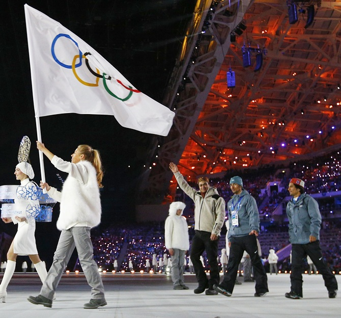 Independent Olympic Indian participants walk at the 2014 Sochi Winter Olympics opening ceremony with the Olympic flag ahead