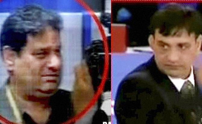 TV grab of Indian officials Rajeev Mehta (left) and Virender Malik
