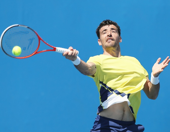 Ivan Dodig of Croatia plays a forehand