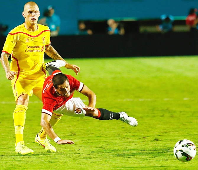 Javier Hernandez  of Manchester United is tackled by Martin Skrtel of Liverpool